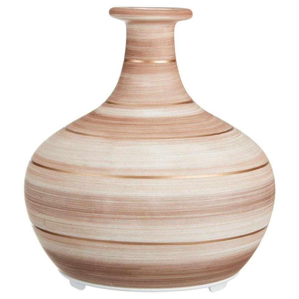 """Everyone will think this is a decorative vase, but you'll know it's also responsible for keeping your home smelling bright and fresh. $60, Walmart. <a href=""""https://www.walmart.com/ip/Ellia-Cordless-Ultrasonic-Aroma-Diffuser-Wander-Essential-Oil-Ceramic-Rechargeable-Diffuser/698245201"""" rel=""""nofollow noopener"""" target=""""_blank"""" data-ylk=""""slk:Get it now!"""" class=""""link rapid-noclick-resp"""">Get it now!</a>"""