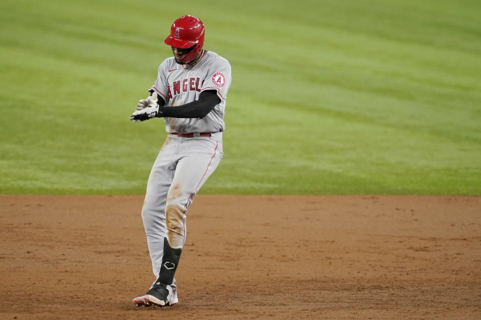 Los Angeles Angels' Jo Adell celebrates his two-RBI double in the third inning of the team's baseball game against the Texas Rangers in Arlington, Texas, Tuesday, Aug. 3, 2021. (AP Photo/Tony Gutierrez)