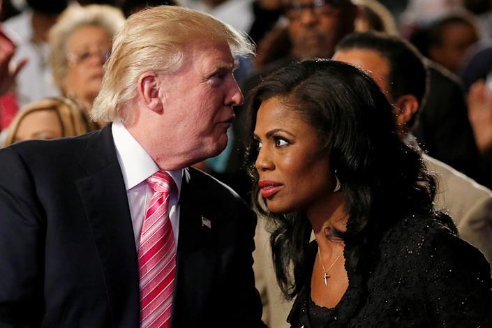 Then presidential candidate Donald Trump and aide Omarosa Manigault attend a church service in Detroit, September 2016. (Photo: Carlo Allegri/Reuters)