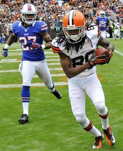 Cleveland Browns wide receiver Travis Benjamin (80) catches a touchdown pass in front of Buffalo Bills defensive back Stephon Gilmore (27) in the third quarter of an NFL football game, Sunday, Sept. 23, 2012, in Cleveland. (AP Photo/David Richard)