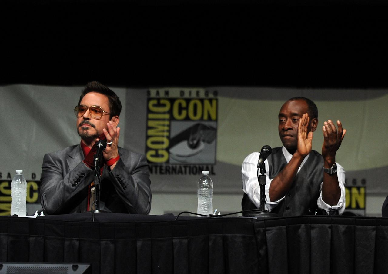 "SAN DIEGO, CA - JULY 14:  Actors Robert Downey Jr. (L) and Don Cheadle speak at Marvel Studios ""Iron Man 3"" panel during Comic-Con International 2012 at San Diego Convention Center on July 14, 2012 in San Diego, California.  (Photo by Kevin Winter/Getty Images)"