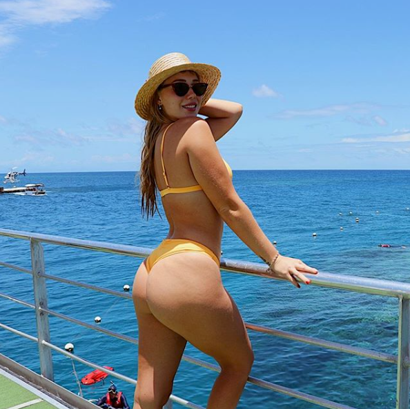 <p>The 22-year-old shows off some serious skin posing on a holiday and getting a bit cheeky. Source: Instagram/edyndenise </p>
