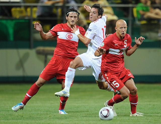 Pablo Sarabia Garcia (C) of Spain vies for the ball with Sezer Ozmen (R) of Turkey during football final tournament of UEFA European Under-19 Championship 2010/2011 in Chiajna village next to Bucharest July 26, 2011. Turkey won 3-0. AFP PHOTO/DANIEL MIHAILESCU (Photo credit should read DANIEL MIHAILESCU/AFP/Getty Images)