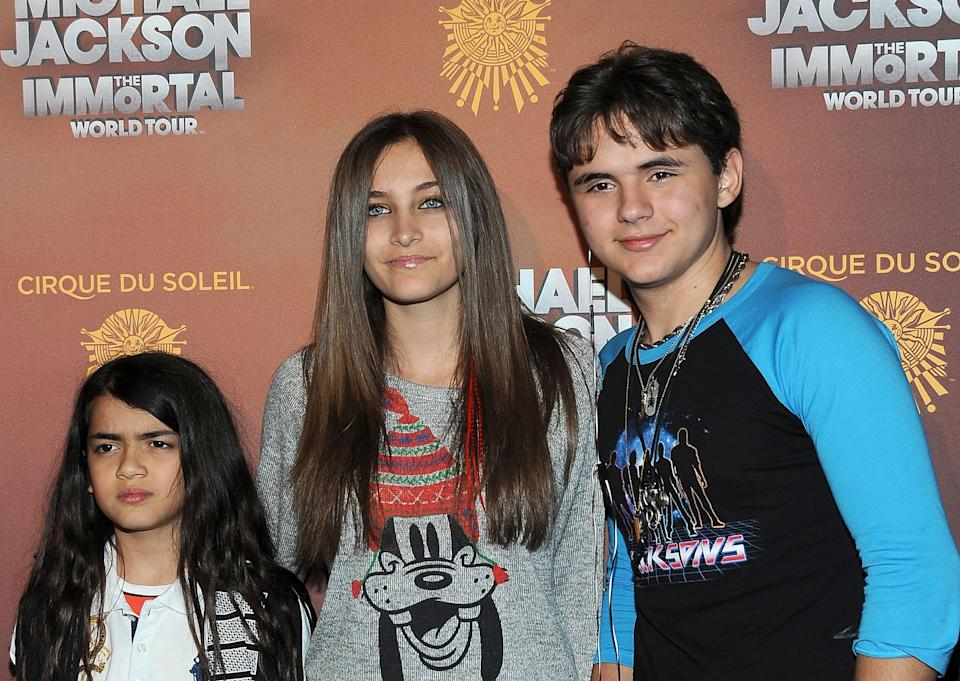 """(L-R) Prince Michael """"Blanket"""" Jackson, Paris Jackson and Prince Jackson arrive at the Michael Jackson The Immortal World Tour in Los Angeles, California, on January 27, 2012.  AFP PHOTO/VALERIE MACON / AFP PHOTO / VALERIE MACON        (Photo credit should read VALERIE MACON/AFP/Getty Images)"""