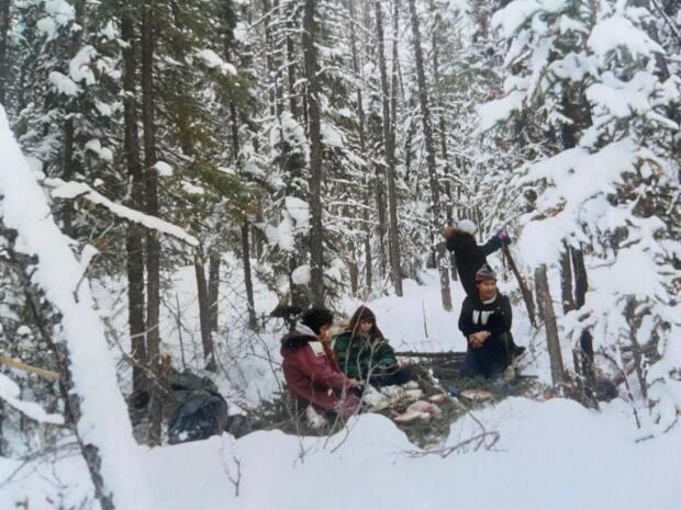 A winter picnic in Łutselk'e, pictured in this undated image. Yamkovy says her goal is to find out what the community needs are when it comes to rejuvenating the language.