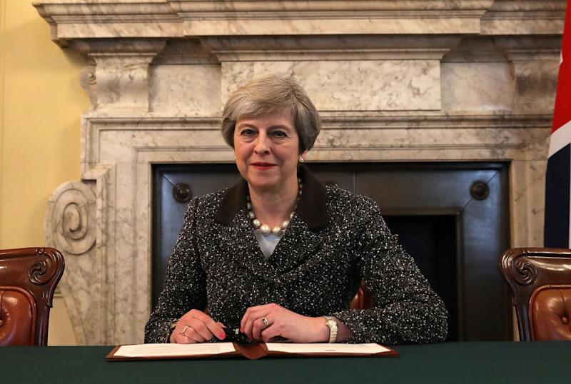 Theresa May signs the official letter to European Council President Donald Tusk, invoking Article 50: Getty