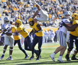 Kansas State defensive back Kiondre Thomas (3) leaps over West Virginia running back Leddie Brown (4) as he attempts to block a pass during an NCAA college football game Saturday, Oct. 31, 2020, in Morgantown, W.Va. (William Wotring/The Dominion-Post via AP)