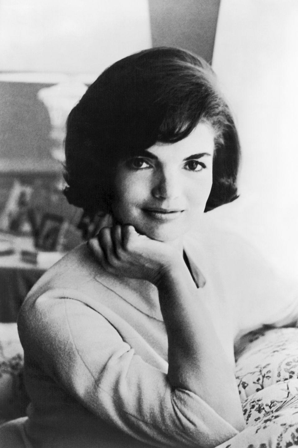 <p>For her first official photograph as First Lady in 1961, the Southampton-born beauty wore a simple long-sleeved sheath. This casual pose illustrated her easy elegance. </p>