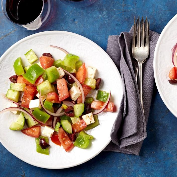 <p>Called horiatiki, this lettuce-free salad made up of tomatoes, cucumber, bell pepper, onion, olives and feta is one of the most popular Greek dishes. It is traditionally served with bread, not pita.</p>