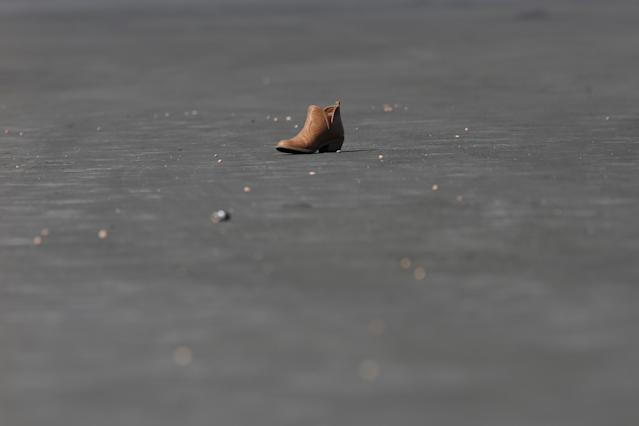 <p>A boot is pictured in the parking lot near the site of the Route 91 music festival mass shooting in Las Vegas, Nev., Oct. 5, 2017. (Photo: Chris Wattie/Reuters) </p>