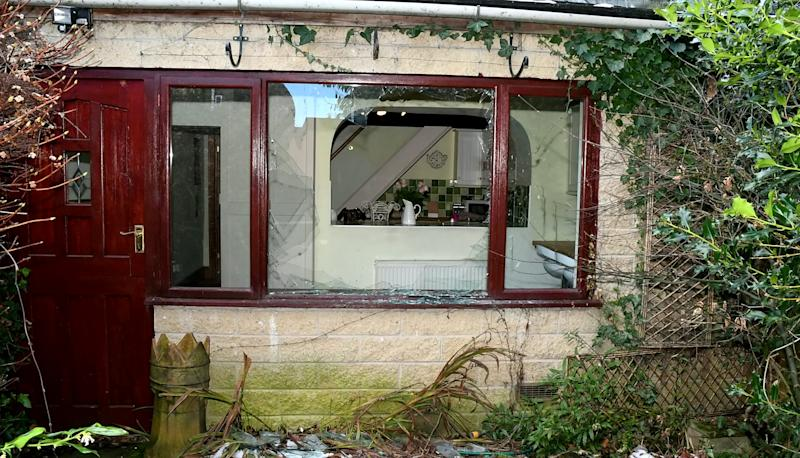 A broken window at the property after Aaron Marsden Booth broke in. (SWNS)