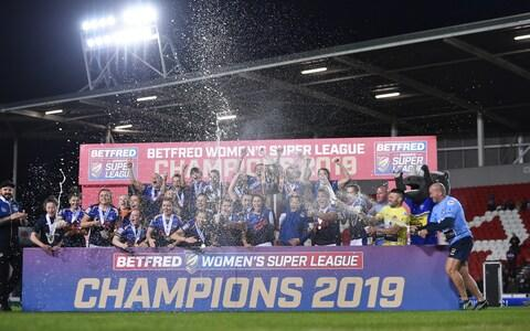 Leeds Rhinos players celebrate after they win the Betfred Womens Supper League - Credit: Getty Images