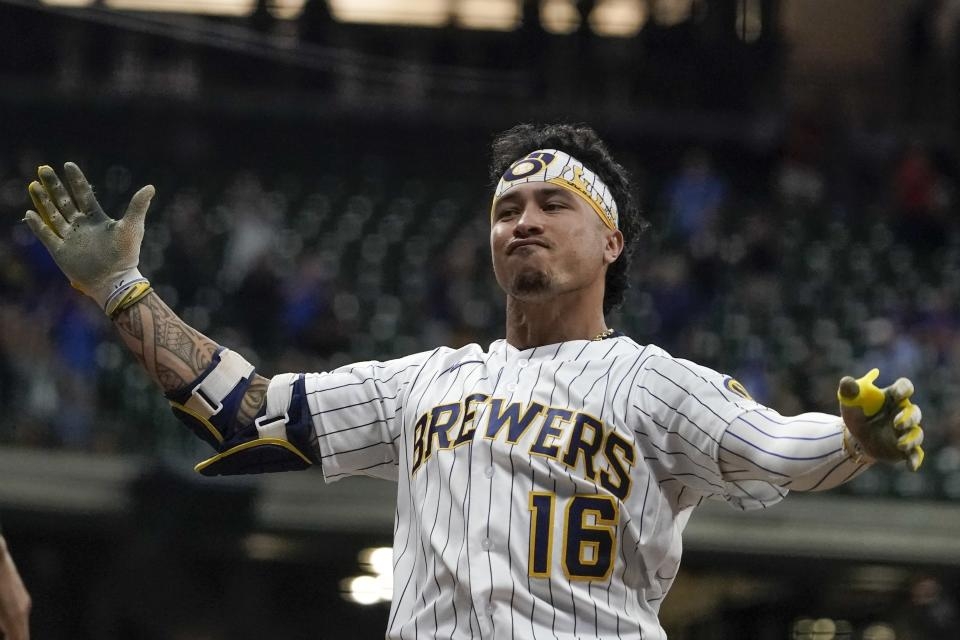 Milwaukee Brewers' Kolten Wong reacts after hitting a two-run scoring single during the eighth inning of a baseball game against the Chicago Cubs Friday, Sept. 17, 2021, in Milwaukee. (AP Photo/Morry Gash)