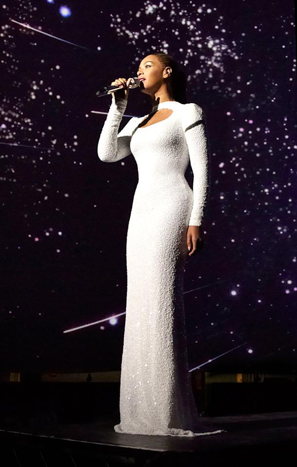 "<p class=""MsoNormal"">Beyonce looked literally out of this world during a performance of ""I Was Here,"" which she gave at the United Nations in honor of World Humanitarian Day. Wearing a sparkling white floor-length Marc Bouwer gown, Bey oozed elegance. (8/10/2012)</p>"
