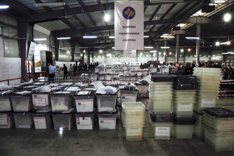 Ballot boxes are seen at Central Election Committee counting center in Fushe Kosove, Kosovo, on Monday, Oct. 7, 2019. Kosovo's opposition parties have won a snap election, overcoming the former independence fighters who have governed the country since its war 20 years ago. With 96% of the votes counted Monday the left-wing Movement for Self-Determination Party, or LVV, has 26% of the votes, one percentage point more than the conservative Democratic League of Kosovo, or LDK, also formerly in opposition. (AP Photo/Visar Kryeziu)