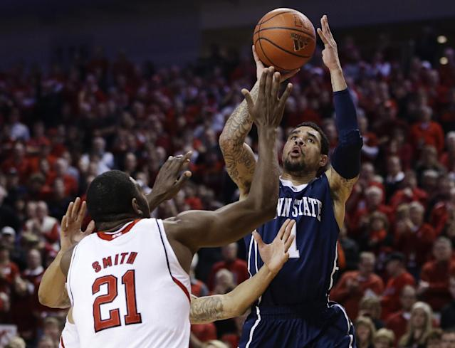 Penn State's John Johnson (1) shoots over Nebraska's Leslee Smith (21) in the first half of an NCAA college basketball game in Lincoln, Neb., Thursday, Feb. 20, 2014. (AP Photo/Nati Harnik)
