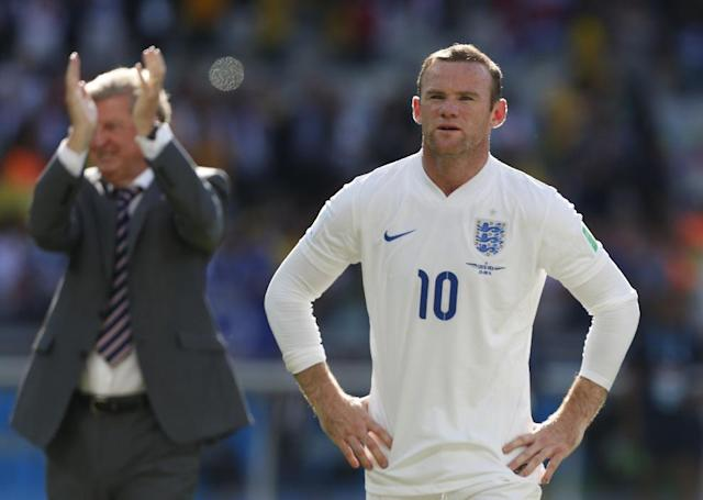 England's Wayne Rooney stands in front of England fans after the group D World Cup soccer match between Costa Rica and England at the Mineirao Stadium in Belo Horizonte, Brazil, Tuesday, June 24, 2014. The match ended in a 0-0 draw. (AP Photo/Jon Super)