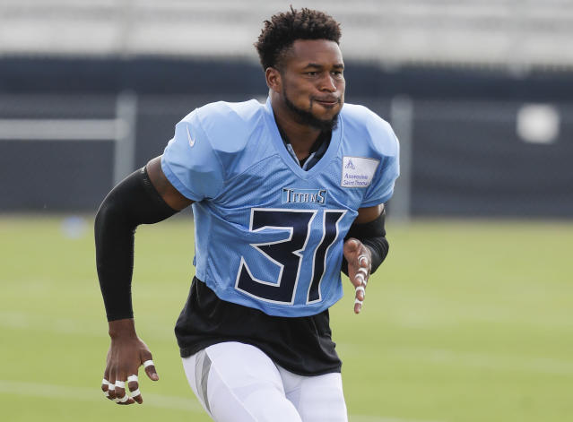 FILE - In this Aug. 1, 2019, file photo, Tennessee Titans free safety Kevin Byard runs a drill during NFL football training camp in Nashville, Tenn. Byard has heard the predictions that the Tennessee Titans will finish last in the AFC South. Byard also remembers the Titans being called Super Bowl contenders after a 3-1 start a year ago. (AP Photo/Mark Humphrey)