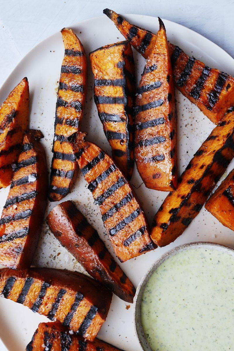 """<p>If you love <a href=""""https://www.delish.com/uk/cooking/recipes/a30311290/how-to-roast-sweet-potatoes/"""" rel=""""nofollow noopener"""" target=""""_blank"""" data-ylk=""""slk:sweet potato"""" class=""""link rapid-noclick-resp"""">sweet potato</a> fries, these grilled sweet potatoes will become your new favourite summer side. The smoky char is everything. Be sure to cut the potatoes into 2cm-thick wedges to make sure they cook all the way through. </p><p>Get the <a href=""""https://www.delish.com/uk/cooking/recipes/a31923466/easy-grilled-sweet-potatoes-recipe/"""" rel=""""nofollow noopener"""" target=""""_blank"""" data-ylk=""""slk:Grilled Sweet Potatoes"""" class=""""link rapid-noclick-resp"""">Grilled Sweet Potatoes</a> recipe.</p>"""