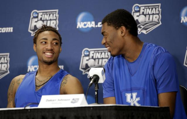 Kentucky guard James Young, left, and center Dakari Johnson chat during a news conference for the NCAA Final Four tournament college basketball championship game Sunday, April 6, 2014, in Arlington, Texas. Kentucky plays Connecticut in the championship game on Monday, April 7. 2014. (AP Photo/Tony Gutierrez)