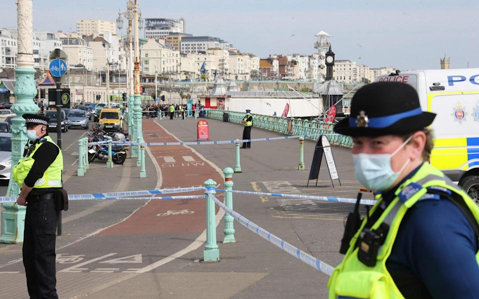 Police cordon off the site as they wait for bomb disposal experts to arrive - Eddie Mitchell