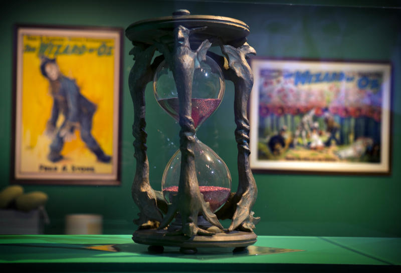 """In this Tuesday, Oct. 8, 2013 photo, the hourglass used in the movie, """"The Wizard of Oz"""" is displayed at the Farnsworth Museum, in Rockland, Maine. The world's largest collection of materials from the movie is being exhibited a few months after the release of a prequel to the original film and the release of the original movie in I-Max format. (AP Photo/Robert F. Bukaty)"""