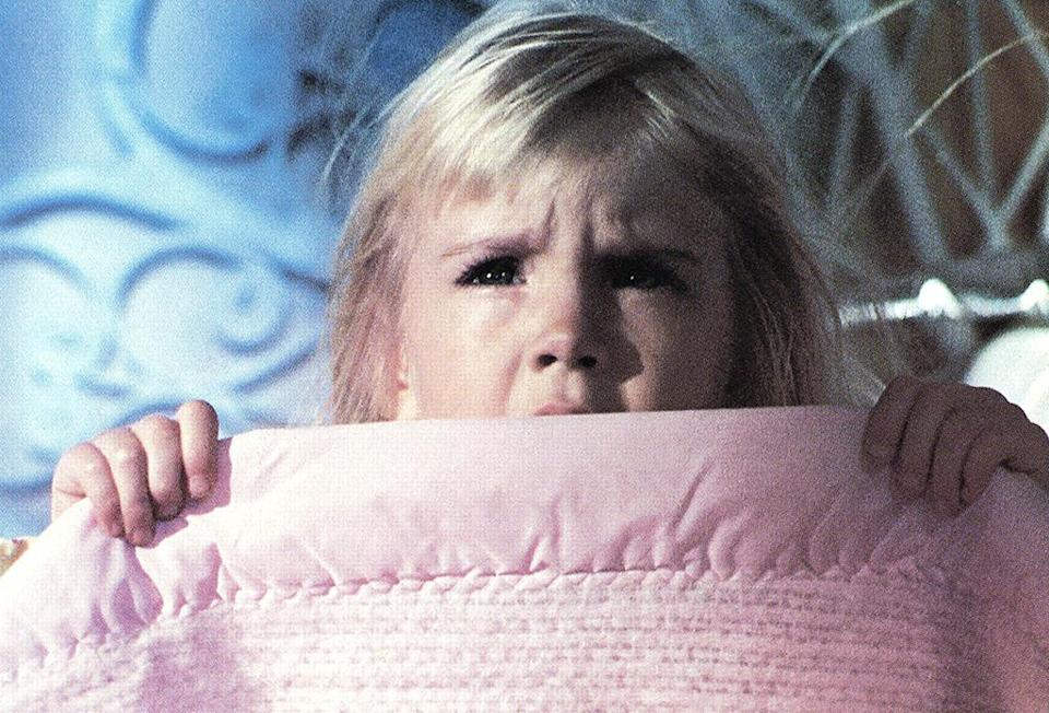 <p>The late Heather O'Rourke freaked out moviegoers as paranormal conduit Carol Anne in three 'Poltergeist' movies in the 1980s. Who can forget the petite psychic Tangina (Zelda Rubinstein) calling her name over and again? (Photo: Everett)</p>