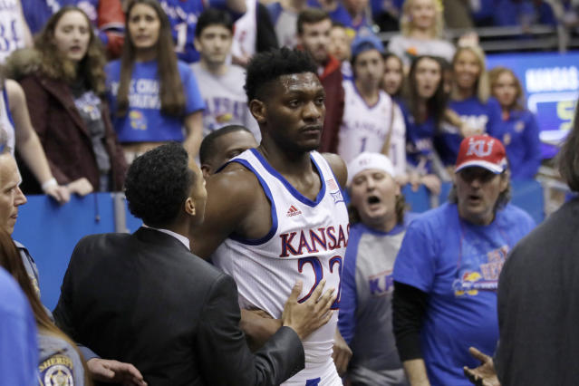 Kansas forward Silvio De Sousa (22) walks out of the crowd after a brawl during the second half of an NCAA college basketball game against Kansas State in Lawrence, Kan., Tuesday, Jan. 21, 2020. Kansas defeated Kansas State 81-59. (AP Photo/Orlin Wagner)