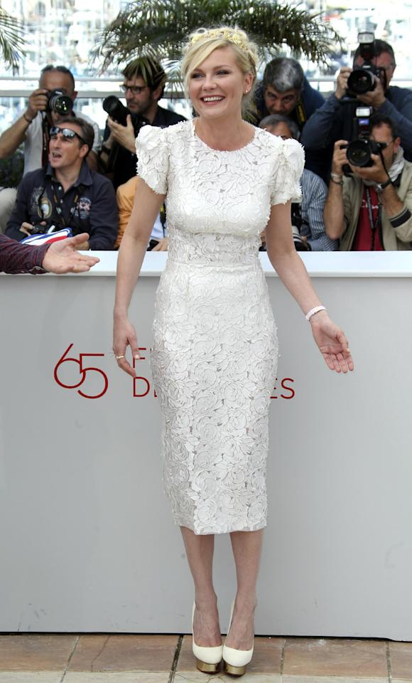 Actress Kirsten Dunst wears Dolce & Gabbana as she poses during a photo call for On the Road at the 65th international film festival, in Cannes, southern France, Wednesday, May 23, 2012. (AP Photo/Joel Ryan)