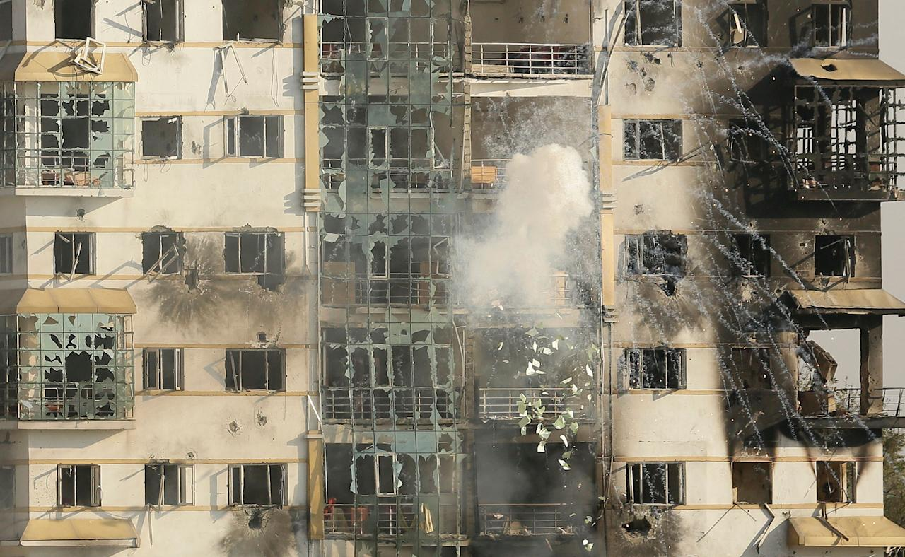 <p>An explosive hits a building where suspected militants have taken refuge during a gun battle in Pampore, on the outskirts of Srinagar, Indian controlled Kashmir, Tuesday, Oct. 11, 2016. A handful of rebels holed up in a building in the Indian portion of Kashmir exchanged fire with government forces for the second straight day on Tuesday. (AP Photo/Mukhtar Khan) </p>