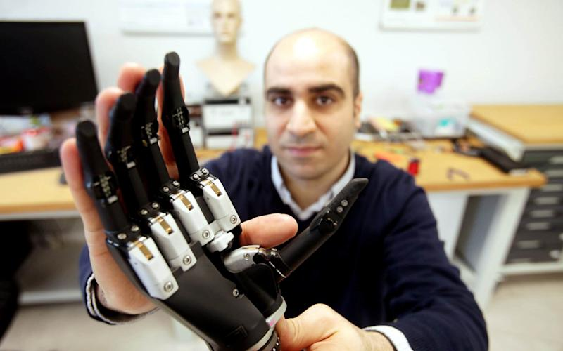 Dr Kianoush Nazarpour demonstrates the bionic hand  - Credit: Mike Urwin/Newcastle University