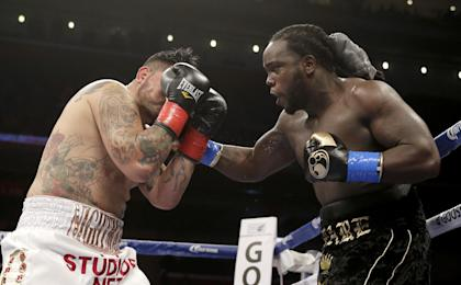 Bermane Stiverne (R) hits Chris Arreola during their rematch for the WBC heavyweight title. (AP)