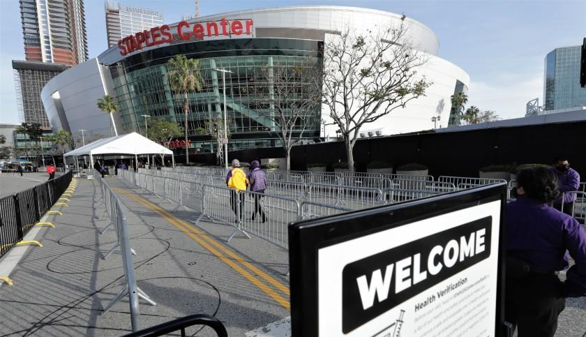A slow trickle of fans head toward the Staples Center entrance for the Lakers-Celtics game on April 15, 2021.