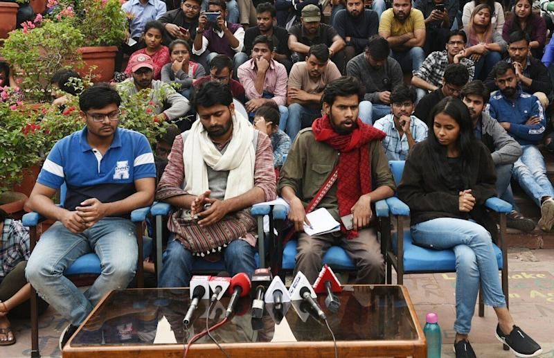 Jawaharlal Nehru University Student Union (JNUSU) Vice President Saket Moon (2R), JNUSU President Aisi Ghosh (R) and other students brief the media outside the admin building while the Executive Council meeting is underway inside the Vice-Chancellors office, at JNU on November 13, 2019 in New Delhi. (Photo: Hindustan Times via Getty Images)
