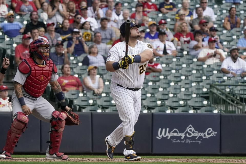 Milwaukee Brewers' Daniel Vogelbach hits a walk-off grand slam during the ninth inning of a baseball game against the St. Louis Cardinals Sunday, Sept. 5, 2021, in Milwaukee. The Brewers won 6-5. (AP Photo/Morry Gash)