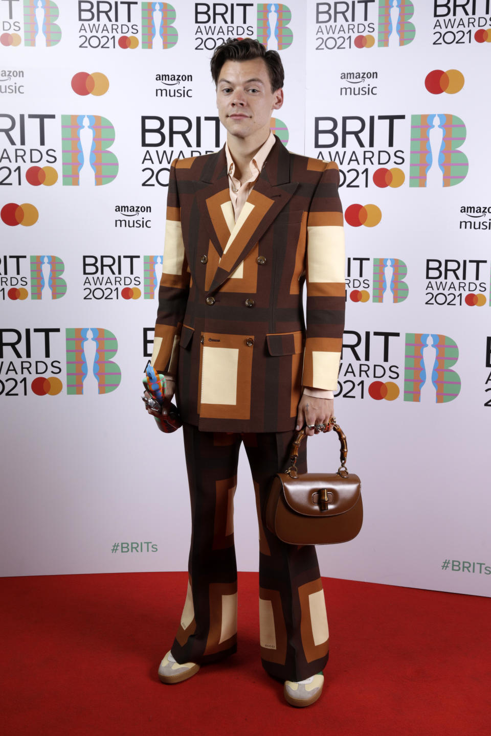 Harry Styles wins the Mastercard British Single award for Watermelon Sugar during The BRIT Awards 2021 at The O2 Arena on May 11, 2021 in London, England.