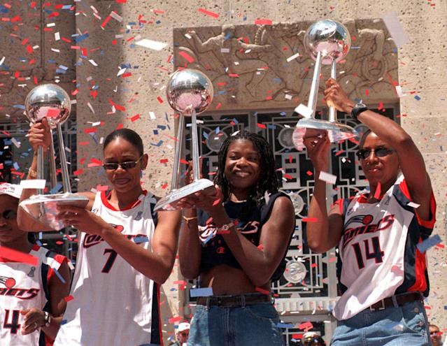 Houston Comets champions Tina Thompson, left, Sheryl Swoopes, center, and Cynthia Cooper were named the best team ever in a Yahoo Sports bracket. (AP Photo/Brett Coomer)