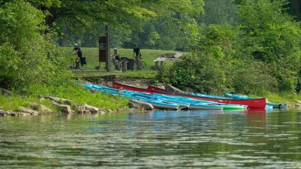 Kayaks and canoes lie on a small beach along the Ottawa River on Monday. (Francis Ferland/CBC - image credit)