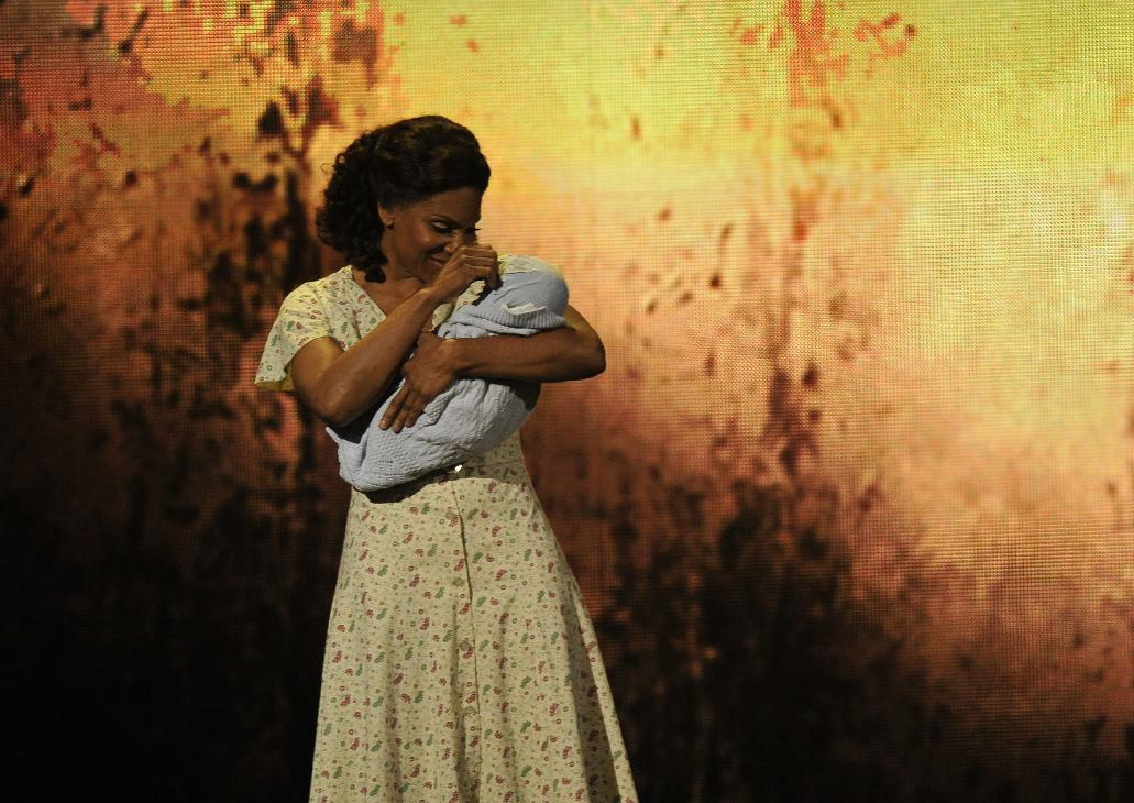 """Audra McDonald performs a scene from """"The Gershwins' Porgy and Bess"""" at the 66th Annual Tony Awards on Sunday June 10, 2012, in New York. The production won a Tony Award for best revival of a musical. (Photo by Charles Sykes /Invision/AP)"""