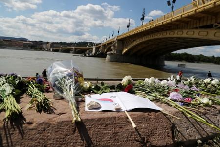Flowers are seen placed next to the Margaret bridge in respect for the victims from a boat carrying South Korean tourists capsized on the Danube river, in Budapest