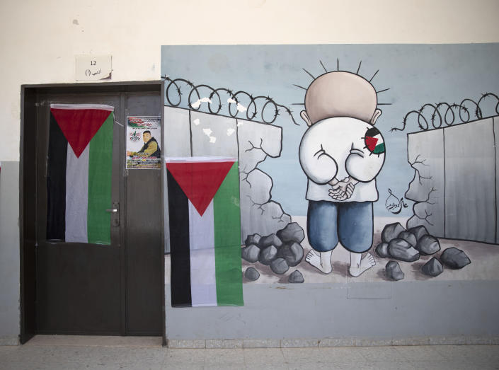 A poster of 17-year-old Palestinian Mohammad Hamayel adorns a door of a classroom, in the village of Beita, south of the West Bank city of Nablus. Monday, June 14, 2021. Hamayel was killed during clashes with Israeli forces following a protest against the wildcat Jewish settlement of Eviatar that was established last month without the permission of Israeli authorities on land the Palestinians say is privately owned. (AP Photo/Majdi Mohammed)