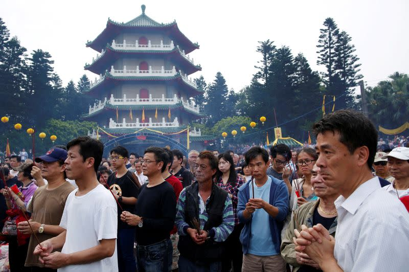 FILE PHOTO: Thousands of people attend an annual worship ceremony to pay respect to their ancestors on Qingming Festival, also known as Tomb Sweeping Day, in Taoyuan, Taiwan