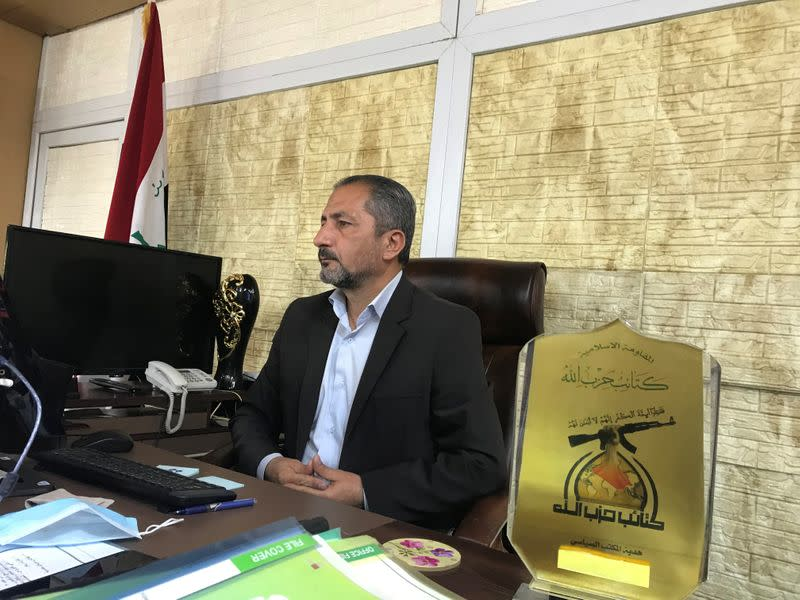 Mohammed Mohi, spokesman for Kataib Hezbollah paramilitary group attends an interview with Reuters in Baghdad