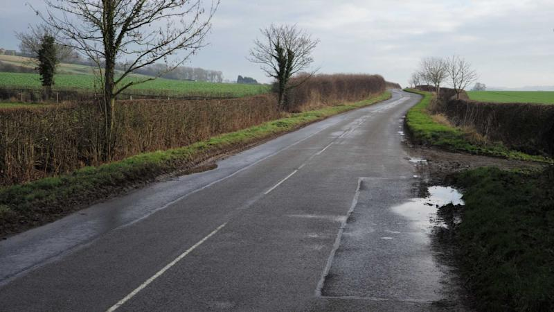Rural wet country road in Leicestershire UK