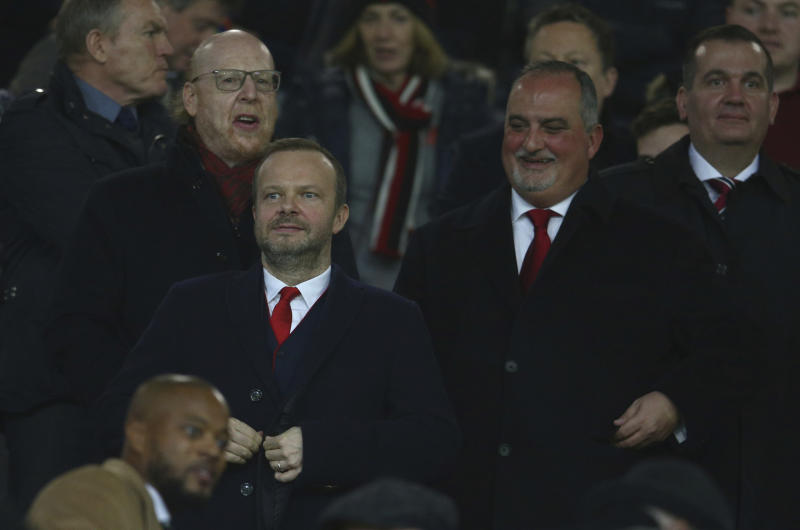 CAPTION CORRECTS TITLE - Ed Woodward the executive vice chairman of Manchester United waits for the start of the Champions League round of 16 soccer match between Manchester United and Paris Saint Germain at Old Trafford stadium in Manchester, England, Tuesday, Feb. 12,2019.(AP Photo/Dave Thompson)