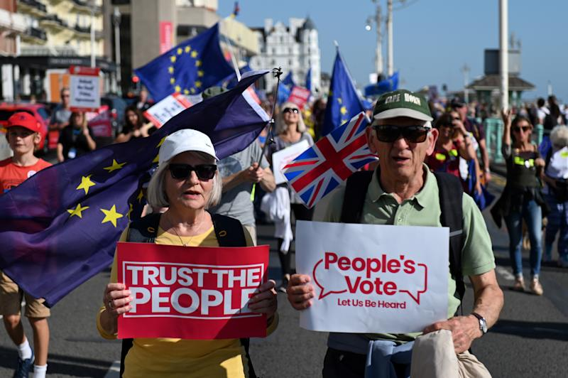 "Protesters gather for a march and rally organised by ""The People's Vote"" in Brighton, on the south coast of England on September 21, 2019, to call for politicians to give the public a final say referendum on Brexit. (Photo by DANIEL LEAL-OLIVAS / AFP) (Photo credit should read DANIEL LEAL-OLIVAS/AFP/Getty Images)"