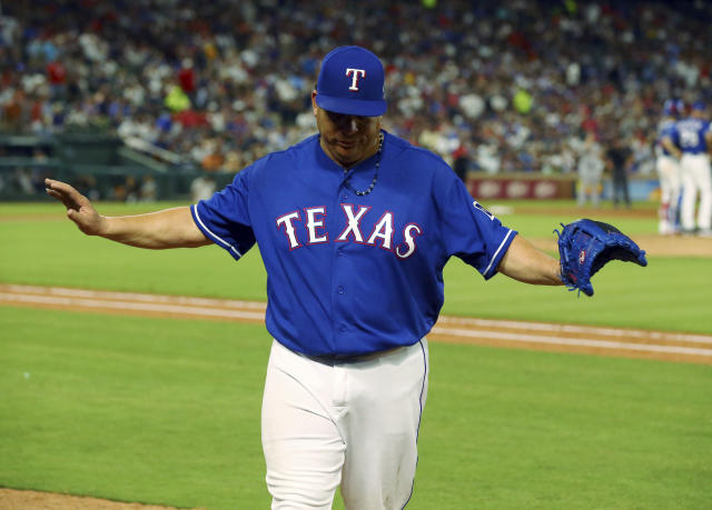 Texas Rangers starting pitcher Bartolo Colon (40) gestures as he walks to the dugout after being pulled in the sixth inning after giving up a home run to New York Yankees Gleyber Torres during a baseball game Monday, May 21, 2018, in Arlington, Texas. (AP Photo/Richard W. Rodriguez)