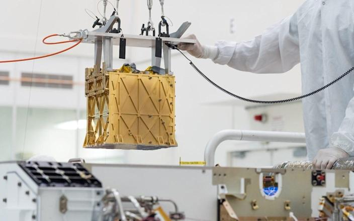 The Mars Oxygen In-Situ Resource Utilisation Experiment - or MOXIE - is a golden box the size of a toaster - NASA/JPL-Caltech/Handout via REUTERS