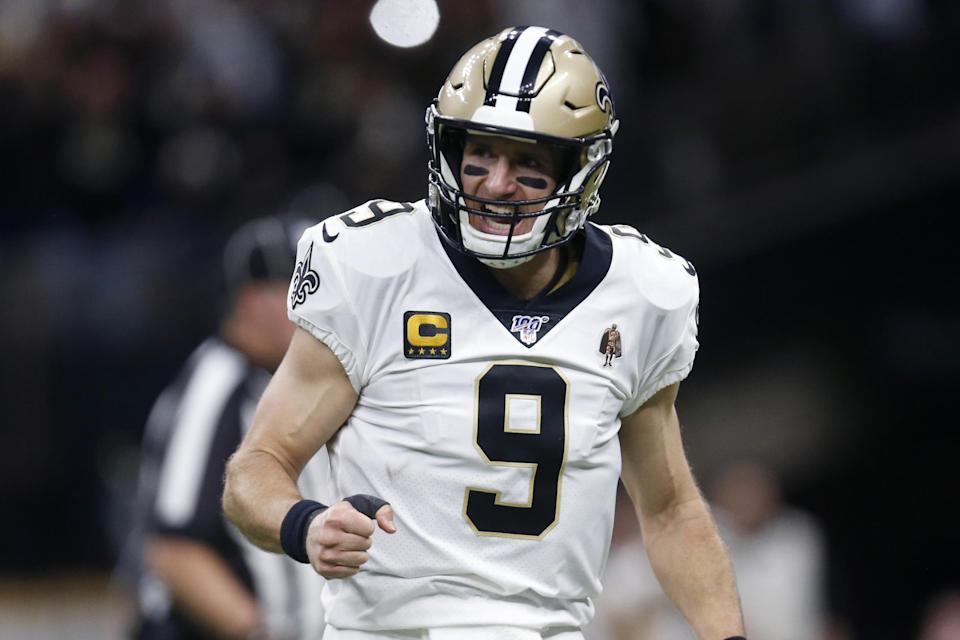 New Orleans Saints quarterback Drew Brees (9) celebrates a touchdown carry by Alvin Kamara in the first half of an NFL wild-card playoff football game against the Minnesota Vikings, Sunday, Jan. 5, 2020, in New Orleans. (AP Photo/Butch Dill)