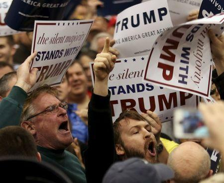 U.S. Republican presidential candidate Donald Trump supporters yell at a protesters as Trump speaks at campaign rally in Cleveland, Ohio March 12, 2016. REUTERS/Aaron Josefczyk
